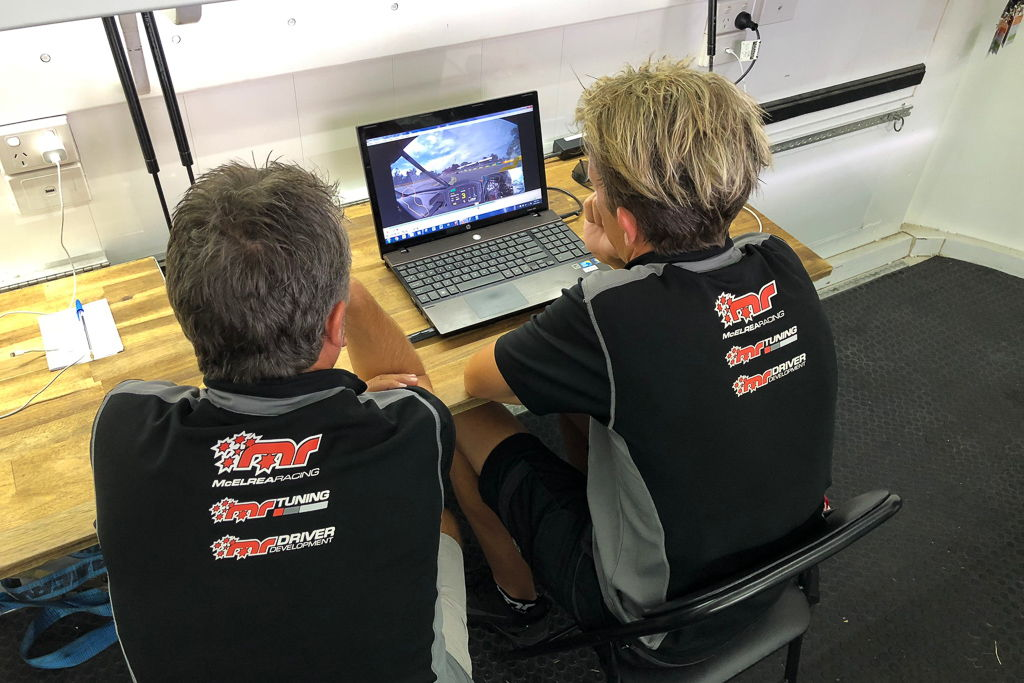 Warren Luff doing video analysis and driver coaching with Tim Miles at the Aust Grand Prix